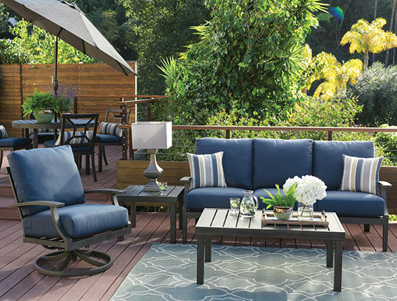 Traditional patio & backyard with martinique set