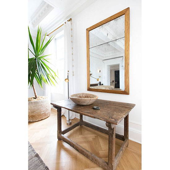 wood table with large mirror room