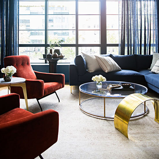 colorful living with red accent chairs