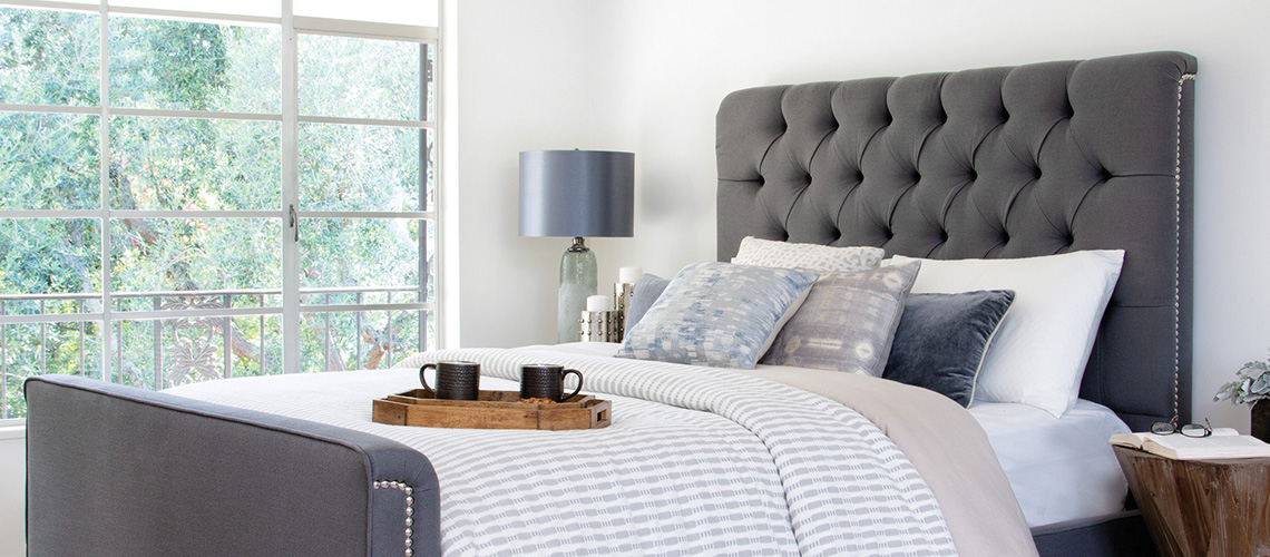 where to store throw pillows when it 39 s time for bed living spaces. Black Bedroom Furniture Sets. Home Design Ideas
