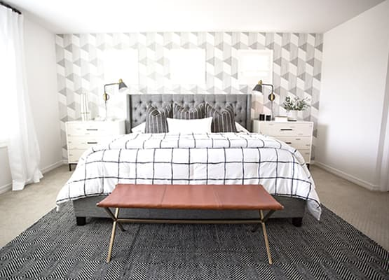 bright white room grey upholstered bed