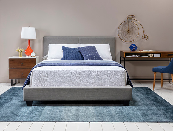 modern Bedroom with Rylee Queen Upholstered Panel Bed
