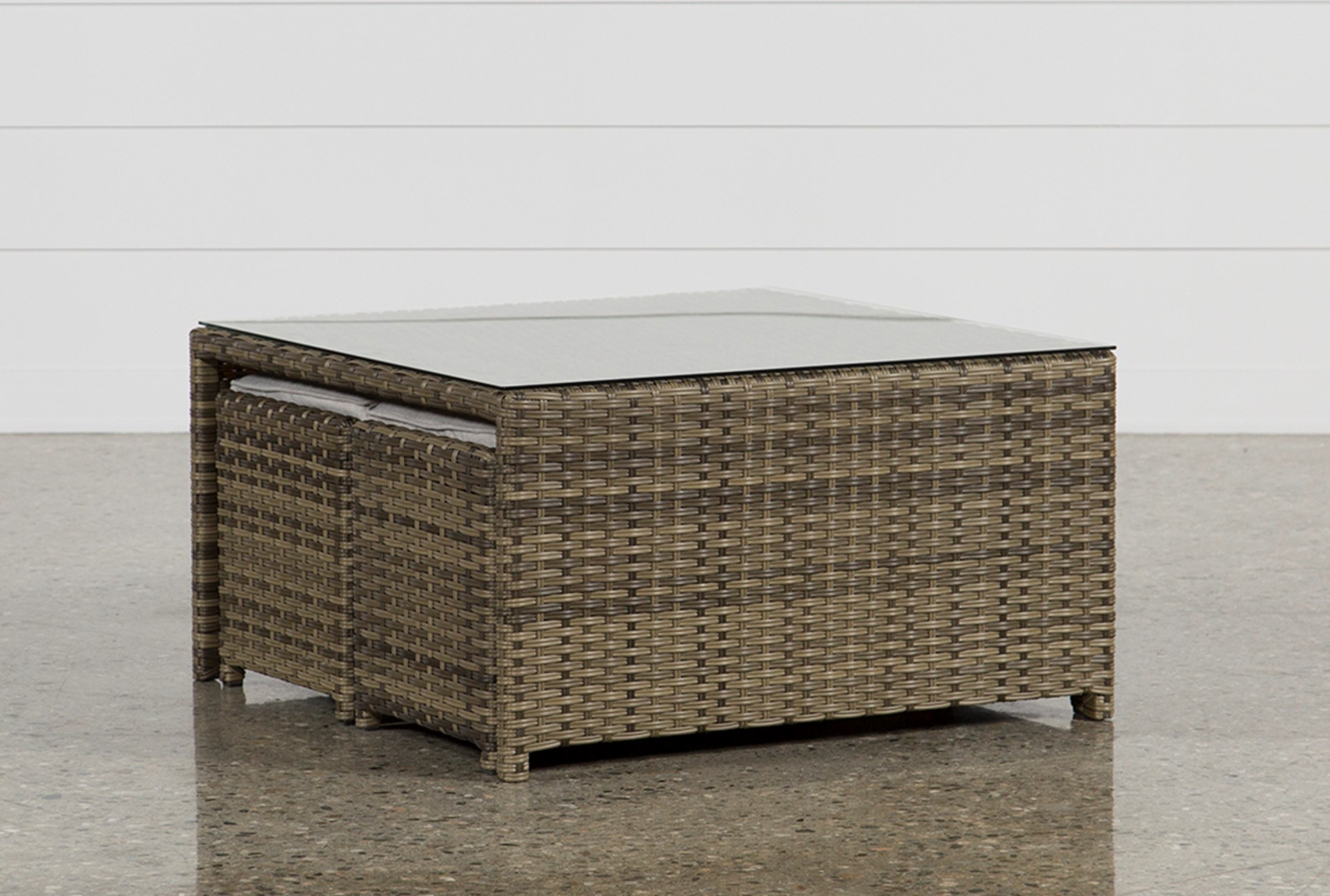 outdoor aventura cocktail table w two ottomans living spaces