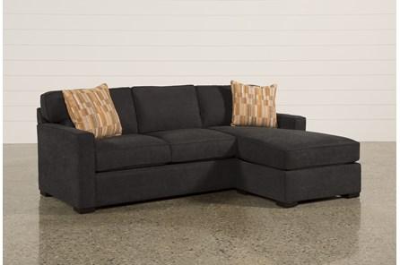 Taren Reversible Sofa Chaise Sleeper W Storage Ottoman