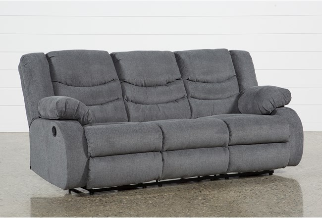 Haines grey reclining sofa living spaces for Sectional sofa hyderabad