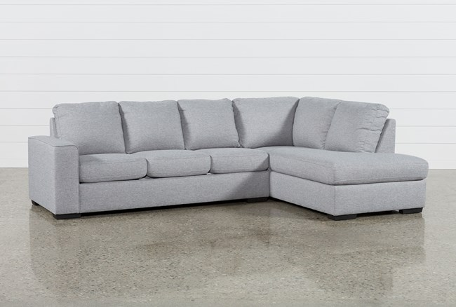 sleeper sectional with chaise Lucy Grey 2 Piece Sleeper Sectional W/Raf Chaise | Living Spaces sleeper sectional with chaise