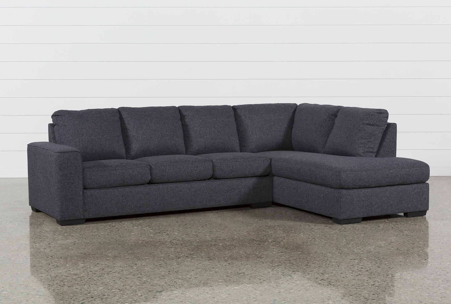 lucy dark grey 2 piece sleeper sectional w raf chaise living spaces rh livingspaces com sleeper sectional sofas sale sleeper sectional sofa canada