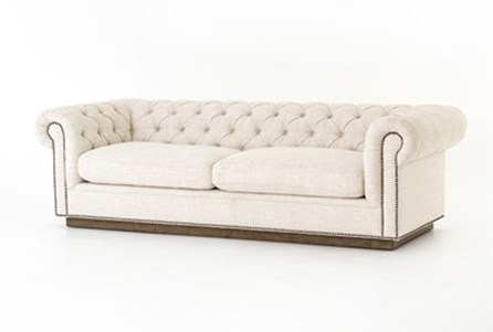 White Tufted Sofa With Studs