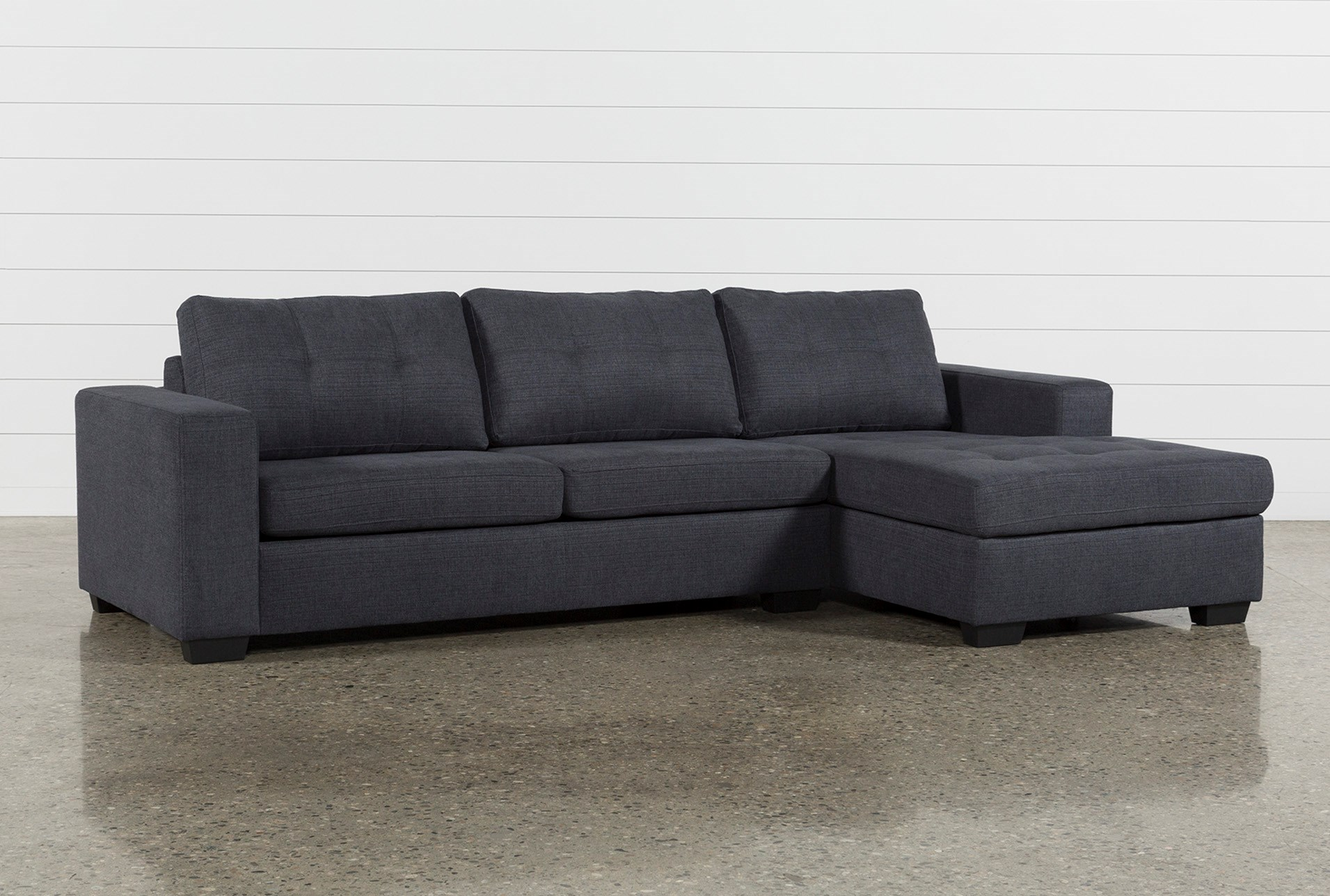 Remington Charcoal 2 Piece Sectional W Right Facing Storage Chaise