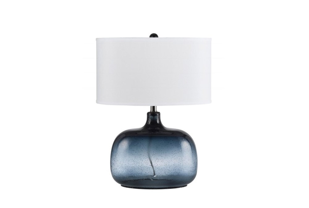 25 Inch Navy Tinted Glass Table Lamp With White Oval Shade
