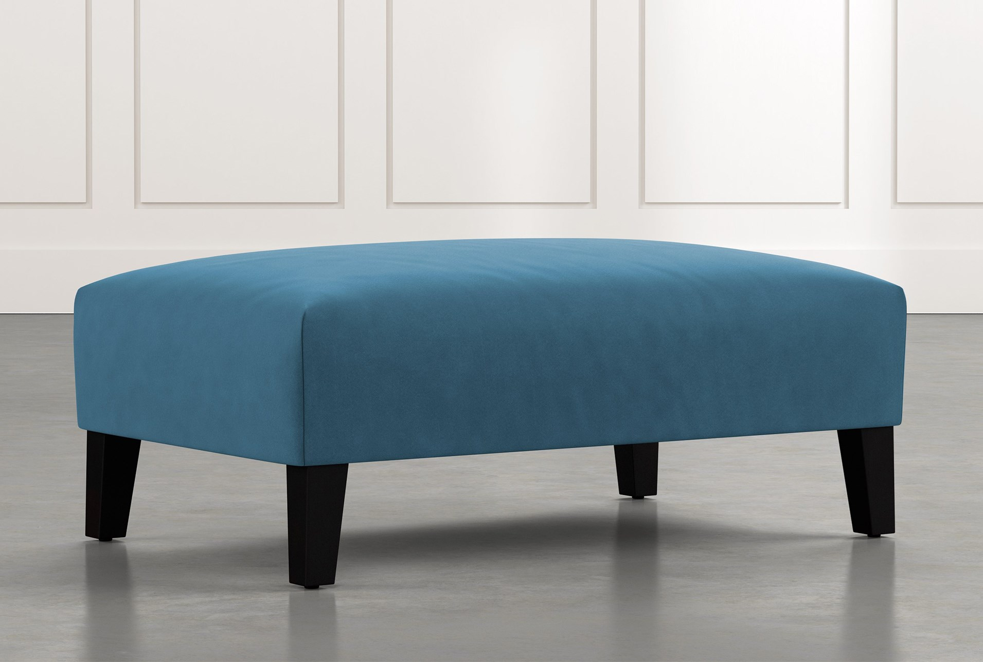 Madalyn Blue Accent Ottoman Living Spaces