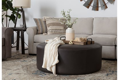 Elm Ii Round Leather Ottoman Living Spaces