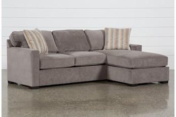 Taren II Reversible Sofa/Chaise Sleeper With Storage Ottoman