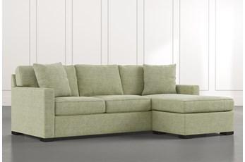 Taren II Green Reversible Sofa/Chaise Sleeper W/Storage Ottoman