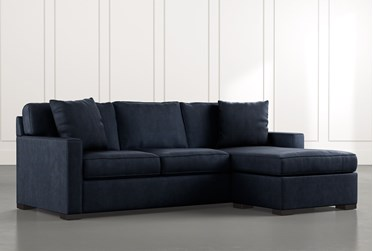 Taren II Navy Blue Reversible Sofa/Chaise Sleeper W/Storage Ottoman