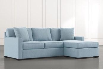 Taren II Light Blue Reversible Sofa/Chaise Sleeper W/Storage Ottoman