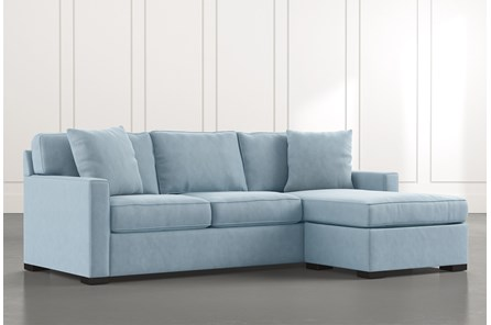 Taren II Light Blue Reversible Sofa/Chaise Sleeper W/Storage Ottoman