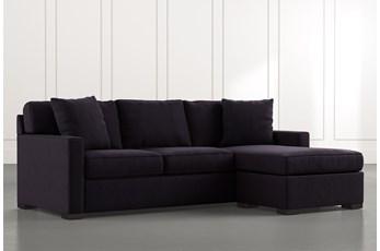 Taren II Black Reversible Sofa/Chaise Sleeper W/Storage Ottoman