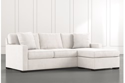 Taren II White Reversible Sofa/Chaise Sleeper W/Storage Ottoman