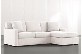 Taren II White Reversible Sofa/Chaise Sleeper W/Storage Ottoman