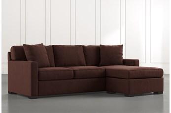 Taren II Brown Reversible Sofa/Chaise Sleeper W/Storage Ottoman
