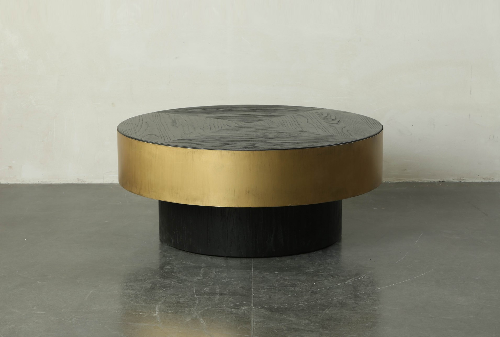 black round coffee table with gold finish