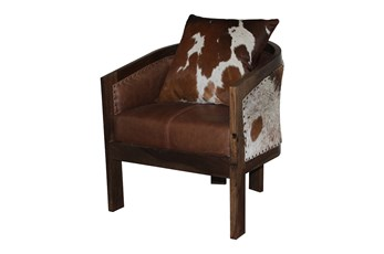 Brown Curved Chair With Cowhide Pillow